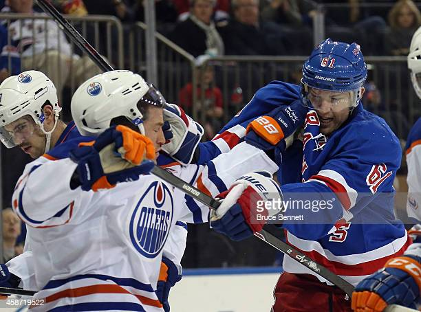 Andrew Ference of the Edmonton Oilers and Rick Nash of the New York Rangers battle in the crease during the second period at Madison Square Garden on...