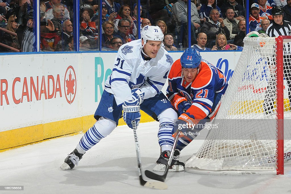 <a gi-track='captionPersonalityLinkClicked' href=/galleries/search?phrase=Andrew+Ference&family=editorial&specificpeople=202264 ng-click='$event.stopPropagation()'>Andrew Ference</a> #21 of the Edmonton Oilers battles for the puck against David Clarkson #71 the Toronto Maple Leafs on October 29, 2013 at Rexall Place in Edmonton, Alberta, Canada.