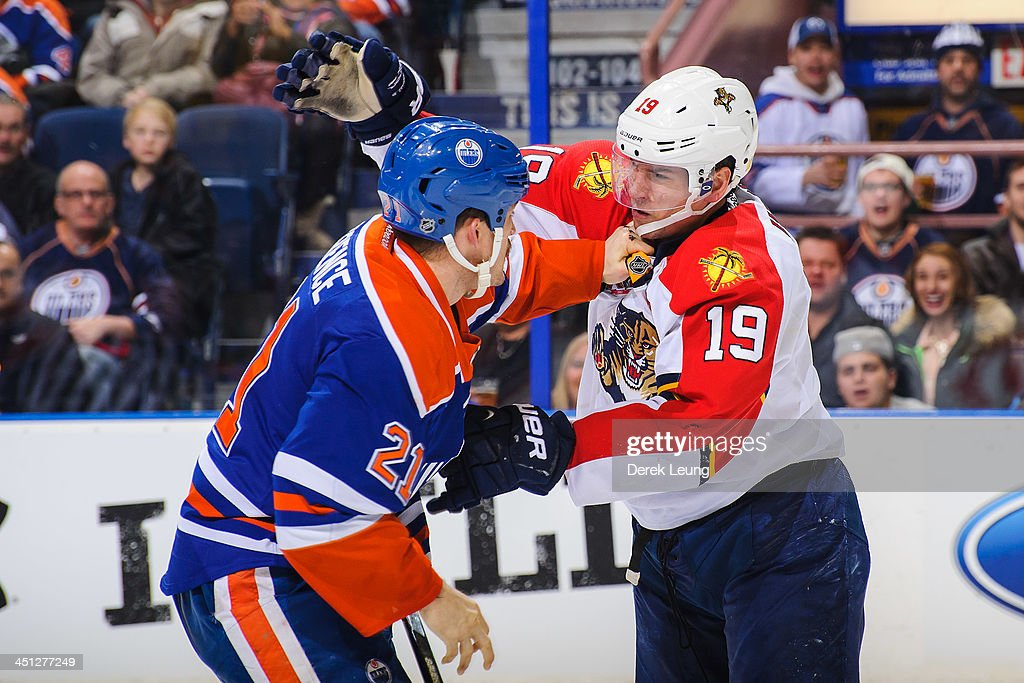 <a gi-track='captionPersonalityLinkClicked' href=/galleries/search?phrase=Andrew+Ference&family=editorial&specificpeople=202264 ng-click='$event.stopPropagation()'>Andrew Ference</a> #21 of the Edmonton Oilers fights <a gi-track='captionPersonalityLinkClicked' href=/galleries/search?phrase=Scottie+Upshall&family=editorial&specificpeople=209198 ng-click='$event.stopPropagation()'>Scottie Upshall</a> #19 of the Florida Panthers during an NHL game at Rexall Place on November 21, 2013 in Edmonton, Alberta, Canada. The Oilers defeated the Panthers 4-1.