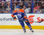 Andrew Ference of the Edmonton Oilers in action against the Buffalo Sabres during an NHL game at Rexall Place on March 20 2014 in Edmonton Alberta...