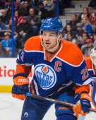 Andrew Ference of the Edmonton Oilers in action against the Calgary Flames during an NHL game at Rexall Place on March 22 2014 in Edmonton Alberta...