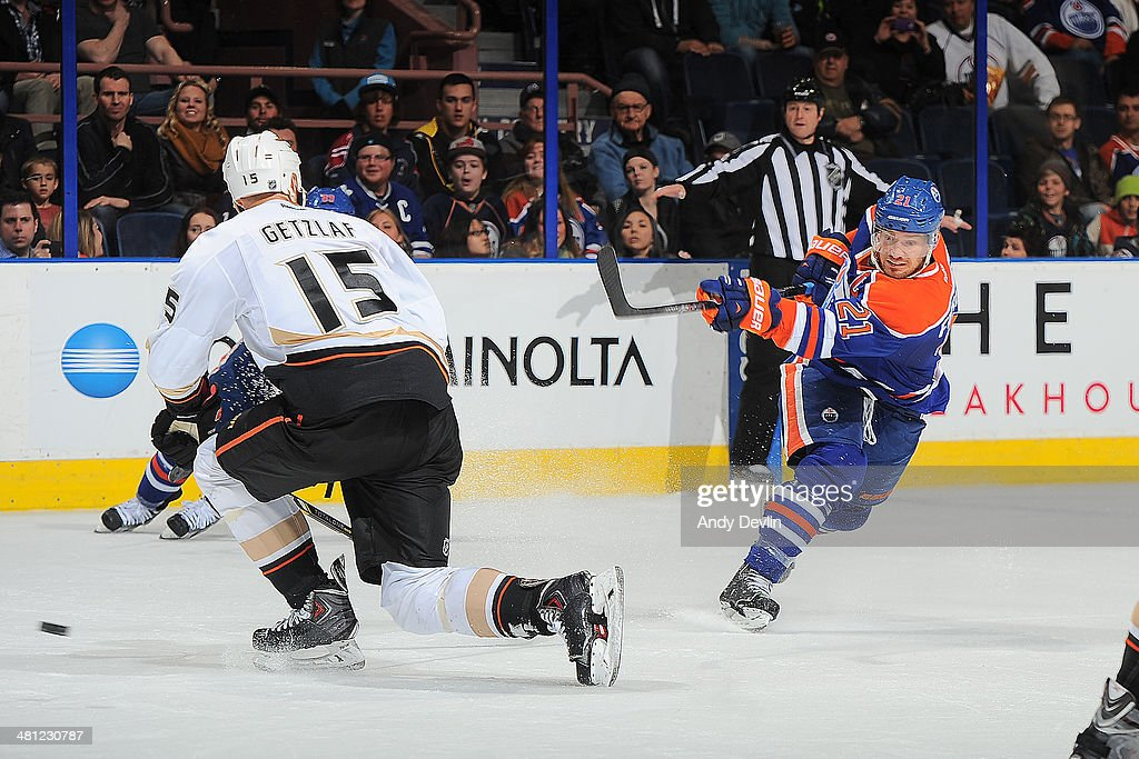 Andrew Ference of the Edmonton Oilers shoots the gamewinning goal in overtime in a game against the Anaheim Ducks on March 28 2014 at Rexall Place in...