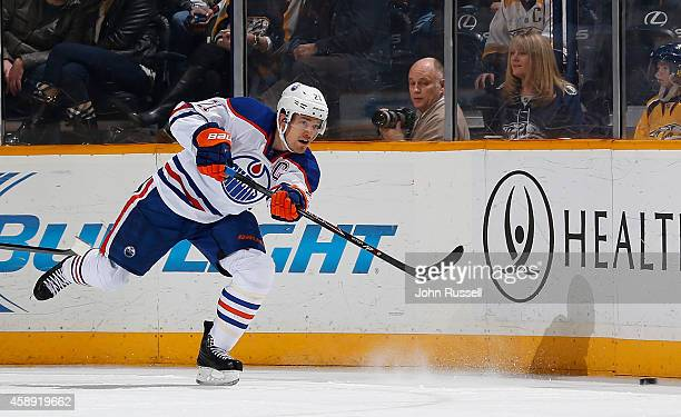 Andrew Ference of the Edmonton Oilers skates against the Nashville Predators at Bridgestone Arena on November 11 2014 in Nashville Tennessee