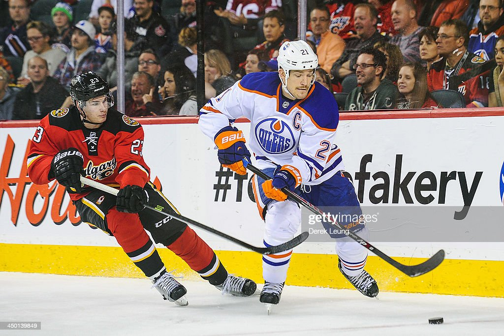 <a gi-track='captionPersonalityLinkClicked' href=/galleries/search?phrase=Andrew+Ference&family=editorial&specificpeople=202264 ng-click='$event.stopPropagation()'>Andrew Ference</a> #21 of the Edmonton Oilers skates with the puck against Sean Monahan #23 of the Calgary Flames during an NHL game at Scotiabank Saddledome on November 16, 2013 in Calgary, Alberta, Canada.