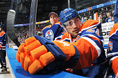 Andrew Ference of the Edmonton Oilers watches from the bench prior to the game against the Florida Panthers on January 11 2015 at Rexall Place in...