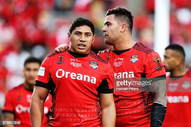 Andrew Fifita and Jason Taumalolo of Tonga embrace during the 2017 Rugby League World Cup Semi Final match between Tonga and England at Mt Smart...