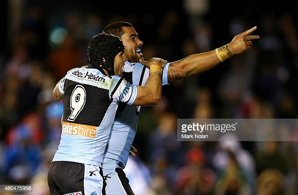 Andrew Fifita and Michael Ennis of the Sharks celebrate a try by Fifita after scoring during the round 18 NRL match between the Cronulla Sharks and...