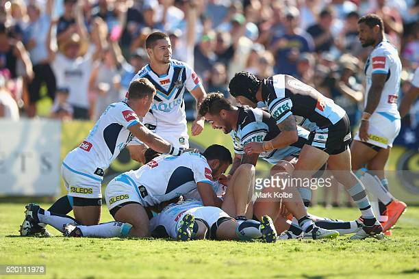 Andrew Fifita and Michael Ennis of the Sharks celebrate a try scored by Matt Prior of the Sharks during the round six NRL match between the Cronulla...