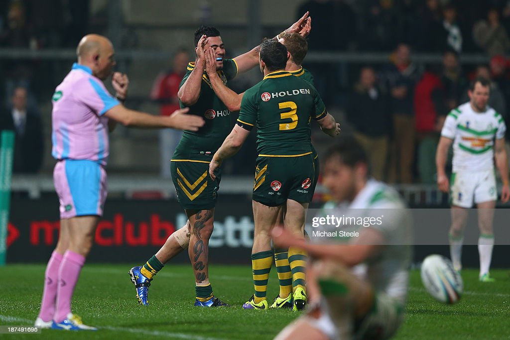 <a gi-track='captionPersonalityLinkClicked' href=/galleries/search?phrase=Andrew+Fifita&family=editorial&specificpeople=6850743 ng-click='$event.stopPropagation()'>Andrew Fifita</a> (L) of Australia celebrates scoring a try with Josh Morris (#3) during the Rugby League World Cup Group A match between Australia and Ireland at Thomond Park on November 9, 2013 in Limerick, .