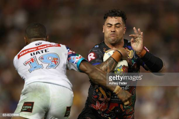 Andrew Fifita of Indigenous All Stars is tackled by Akuila Uate of the World All Stars during the NRL All Stars match between the 2017 Harvey Norman...
