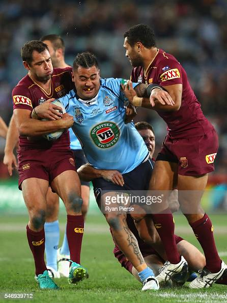 Andrew Fifita of the Blues is tackled by Cameron Smith of the Maroons during game three of the State Of Origin series between the New South Wales...
