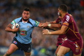 Andrew Fifita of the Blues is tackled during game three of the ARL State of Origin series between the New South Wales Blues and the Queensland...