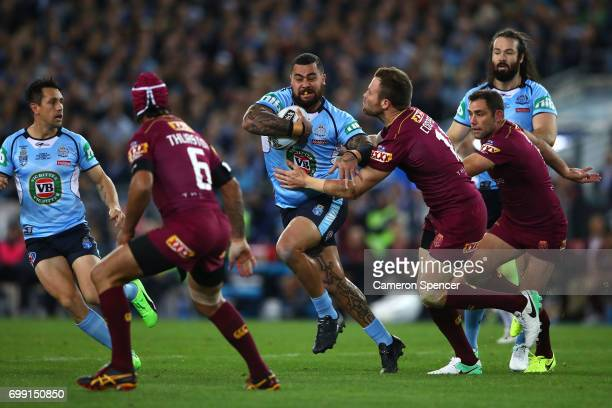 Andrew Fifita of the Blues is tackled during game two of the State Of Origin series between the New South Wales Blues and the Queensland Maroons at...