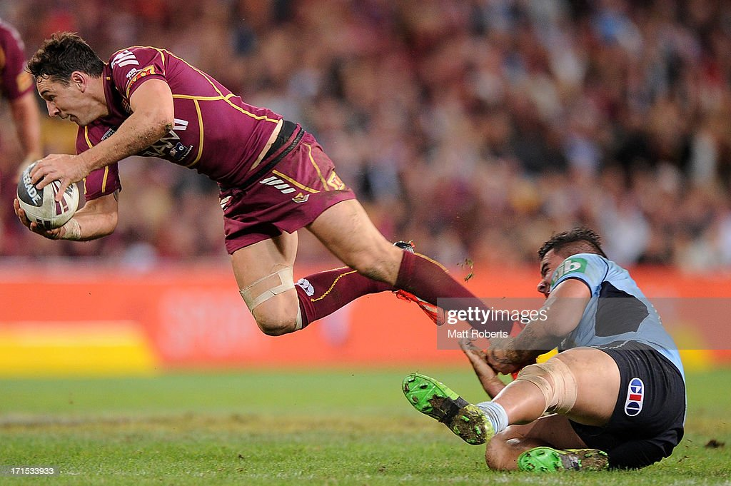 Andrew Fifita of the Blues tackles <a gi-track='captionPersonalityLinkClicked' href=/galleries/search?phrase=Billy+Slater&family=editorial&specificpeople=171206 ng-click='$event.stopPropagation()'>Billy Slater</a> of the Maroons during game two of the ARL State of Origin series between the Queensland Maroons and the New South Wales Blues at Suncorp Stadium on June 26, 2013 in Brisbane, Australia.