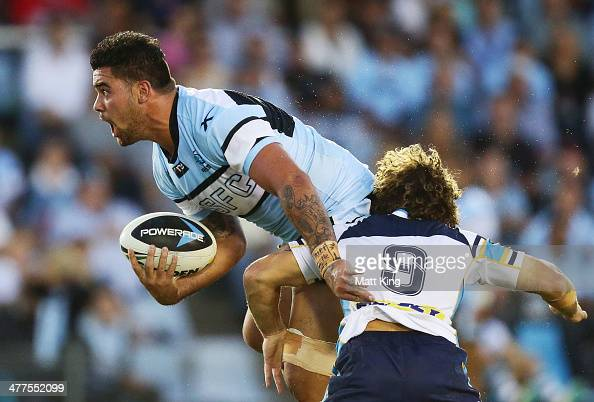 Andrew Fifita of the Sharks is tackled by Beau Falloon of the Titans during the round one NRL match between the Cronulla Sharks and the Gold Coast...