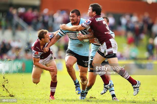Andrew Fifita of the Sharks is tackled by Jamie Lyon and Daly CherryEvans of the Sea Eagles during the round 6 NRL match between the ManlyWarringah...