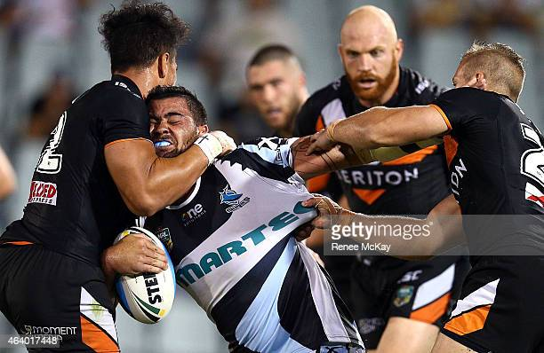 Andrew Fifita of the Sharks is tackled by the Tigers defence during the NRL Trial Match between the Wests Tigers and the Cronulla Sharks at...