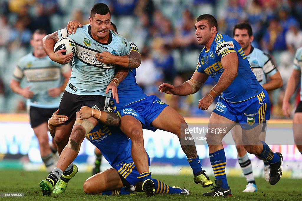 Andrew Fifita of the Sharks is tackled during the round five NRL match between the Parramatta Eels and the Cronulla Sharks at Parramatta Stadium on April 6, 2013 in Sydney, Australia.