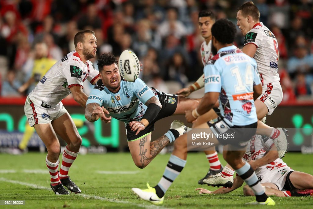 Andrew Fifita of the Sharks passes as he is tackled during the round 10 NRL match between the St George Illawarra Dragons and the Cronulla Sharks at UOW Jubilee Oval on May 12, 2017 in Sydney, Australia.