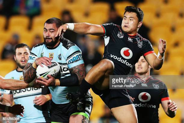 Andrew Fifita of the Sharks secures the high ball over Mason Lino of the Warriors during the round 21 NRL match between the New Zealand Warriors and...