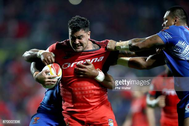 Andrew Fifita of Tonga is tackled during the 2017 Rugby League World Cup match between Samoa and Tonga at Waikato Stadium on November 4 2017 in...