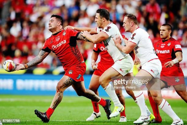 Andrew Fifita of Tonga offloads the ball during the 2017 Rugby League World Cup Semi Final match between Tonga and England at Mt Smart Stadium on...