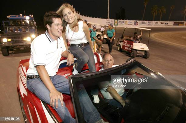 Andrew Firestone of ABC's The Bachelor and his fiancee Jen Schefft snuggle together as they wave to fans at the Route 66 Rendezvous The Firestone...