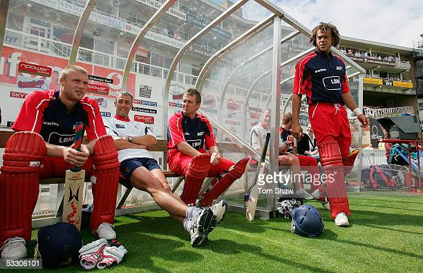 Andrew Flintoff and Andrew Symonds of Lancashire look on from the dugout during the Twenty20 Semi Final match between Surrey and Lancashire at the...