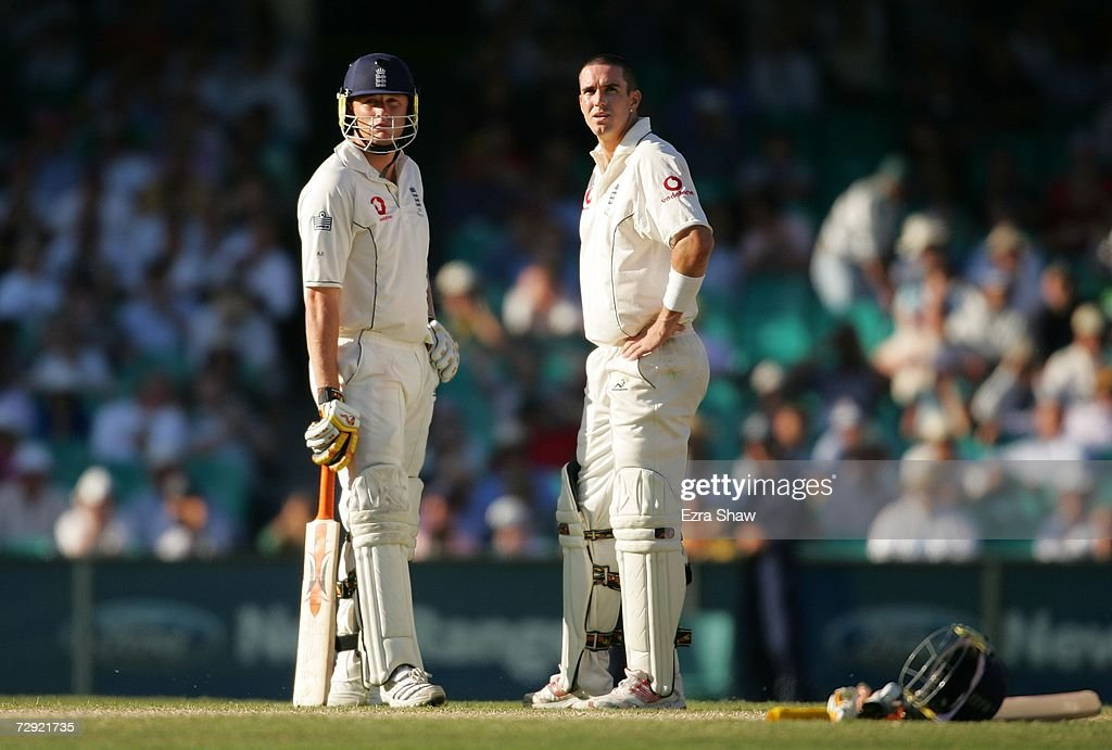 Andrew Flintoff and Kevin Pietersen of England await the third umpire's decision on the stumping by Adam Gilchrist of Flintoff off the bowling of...