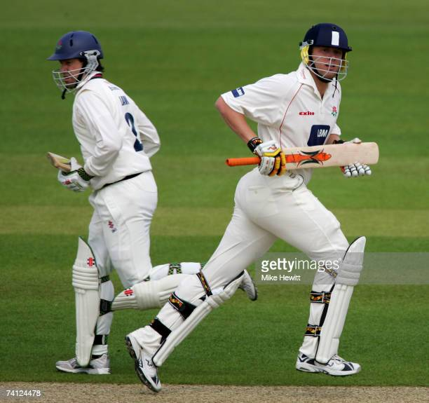Andrew Flintoff and Stuart Law of Lancashire in action during their 61 run partnership in the LV County Championship match between Hampshire and...