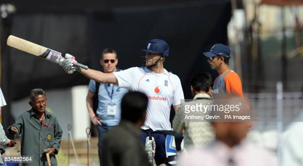 Andrew Flintoff exchanges words with Indian bowling coach Venkatesh Prasad after Andy Flower was almost hit by a ball during a training session at...