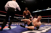 Andrew Flintoff in action with Richard Dawson during their International Heavyweight bout at MEN Arena on November 30 2012 in Manchester England