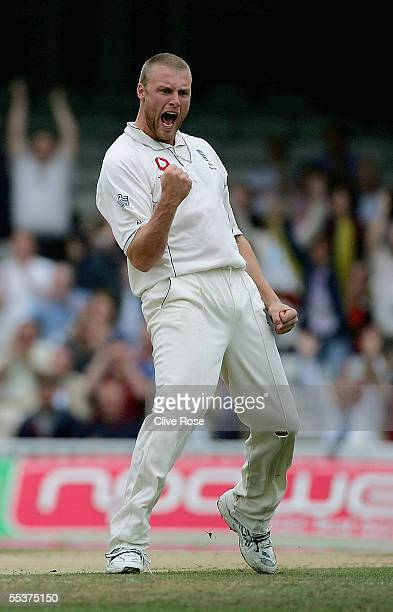 Andrew Flintoff of England celebrates taking the wicket of Damien Martyn of Australia during day four of the fifth npower Ashes Test match between...