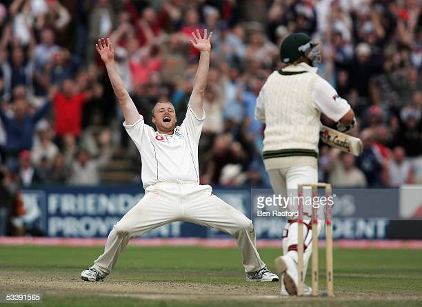 Andrew Flintoff of England celebrates taking the wicket of Shane Warne of Australia during day five of the third npower Ashes Test match between...