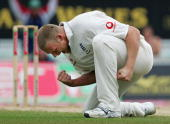 Andrew Flintoff of England celebrates the wicket of Shane Warne of Australia during day four of the Fifth npower Ashes Test between England and...