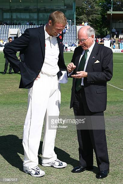 Andrew Flintoff of England chats with Australian Prime Minister John Howard before the coin toss for the first Ashes tour match between the...