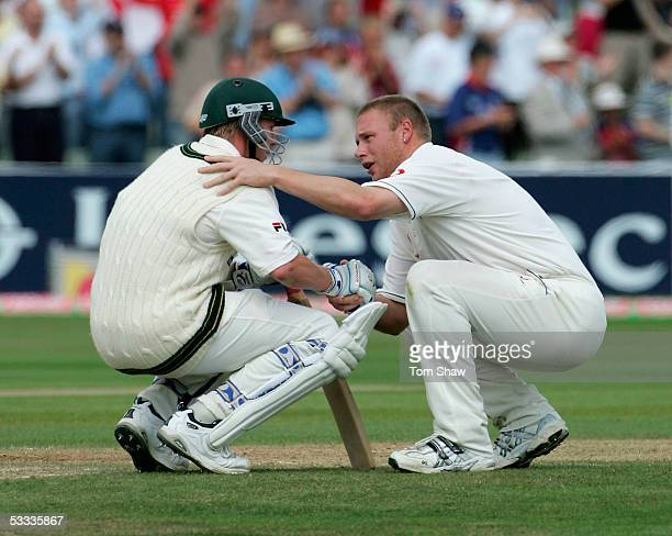 Andrew Flintoff of England consoles Brett Lee of Australia after England defeated Australia on day four of the Second npower Ashes Test match between...