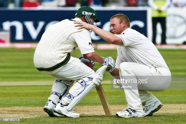 Andrew Flintoff of England consoles Brett Lee of Australia after England won the 2nd Ashes Test Match by two runs at the Edgbaston cricket ground on...