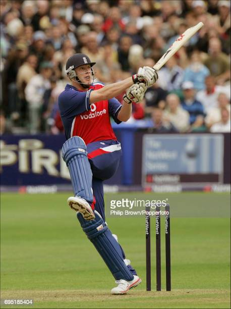 Andrew Flintoff of England hits a four off Ian Butler of New Zealand during the England v New Zealand Natwest series ODI match at the County Ground...