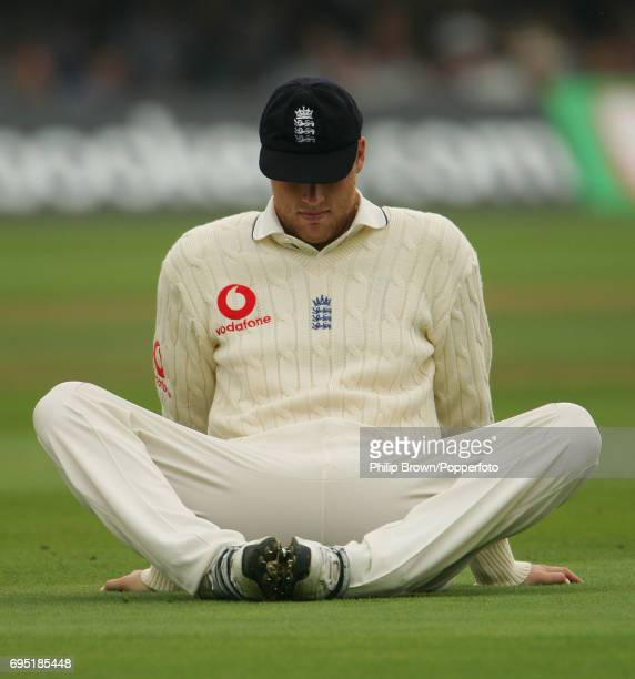 Andrew Flintoff of England looks dejected as he takes a break during the 1st Ashes Test match between England and Australia at Lord's Cricket Ground...