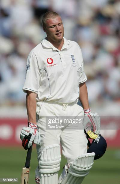 Andrew Flintoff of England walks off after being bowled out by Glenn McGrath of Australia during day one of the first npower Ashes Test match between...