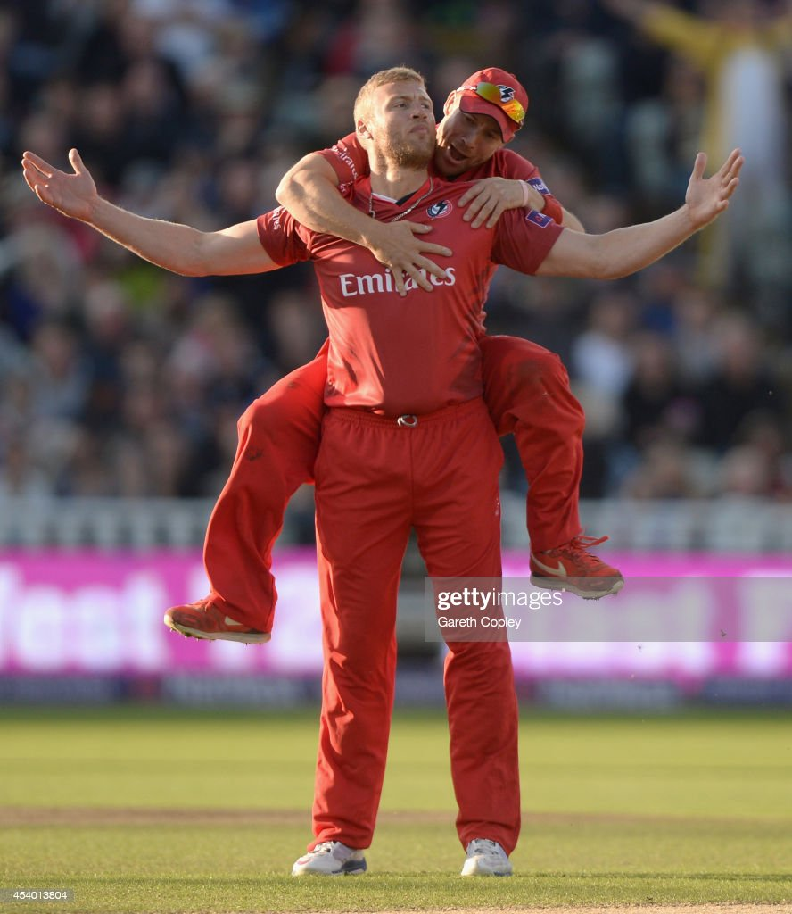 <a gi-track='captionPersonalityLinkClicked' href=/galleries/search?phrase=Andrew+Flintoff&family=editorial&specificpeople=171169 ng-click='$event.stopPropagation()'>Andrew Flintoff</a> of Lancashire celebrates with Paul Horton after dismissing Ian Bell of Birmingham Bears during the Natwest T20 Blast final between Lancashire Lighting and Birmingham Bears at Edgbaston on August 23, 2014 in Birmingham, England.