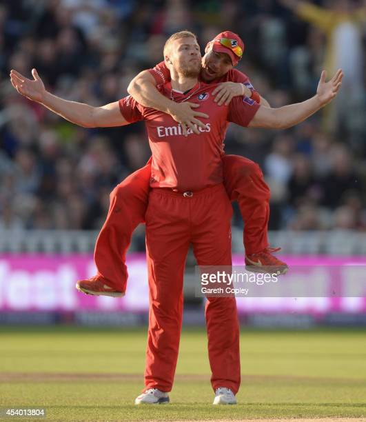 Andrew Flintoff of Lancashire celebrates with Paul Horton after dismissing Ian Bell of Birmingham Bears during the Natwest T20 Blast final between...
