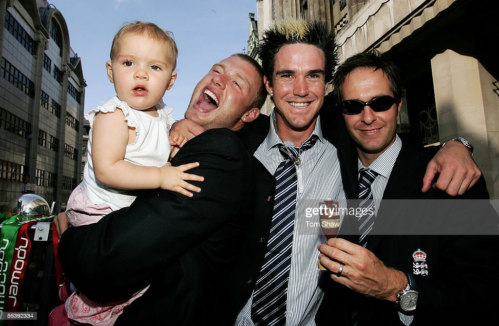 Andrew Flintoff poses with his daughter Holly and (L-R) Kevin Pietersen and captain Michael Vaughan for a photograph aboard the parade bus on the way to Trafalgar Square as part of the Ashes victory celebration, September 13, 2005 in London.