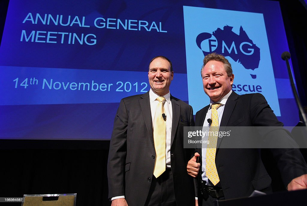 Andrew Forrest, chairman of Fortescue Metals Group Ltd., right, and Neville 'Nev' Power, chief executive officer, stand for photographs at the company's annual general meeting in Perth, Australia, on Wednesday, Nov. 14, 2012. Forrest, founder of Fortescue Metals, last month defeated a regulator's claim that he misled shareholders of the iron-ore exporter which made him Australia's fourth-richest person. Photographer: Sergio Dionisio/Bloomberg via Getty Images
