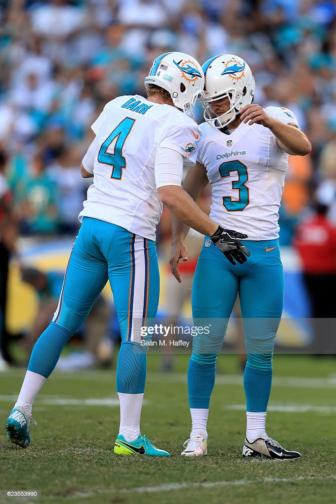 9a59710ce ... Womens Limited Black 2017 Salute to Service Jersey Andrew Franks 3 and  Matt Darr 4 of the Miami Dolphins react after a Mens Nike ...