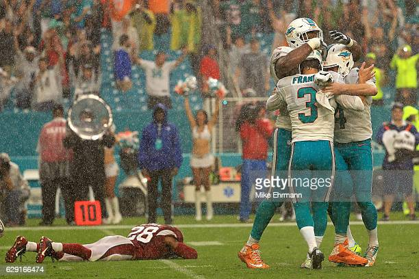 Andrew Franks of the Miami Dolphins celebrates a game winning field goal during a game against the Arizona Cardinals at Hard Rock Stadium on December...