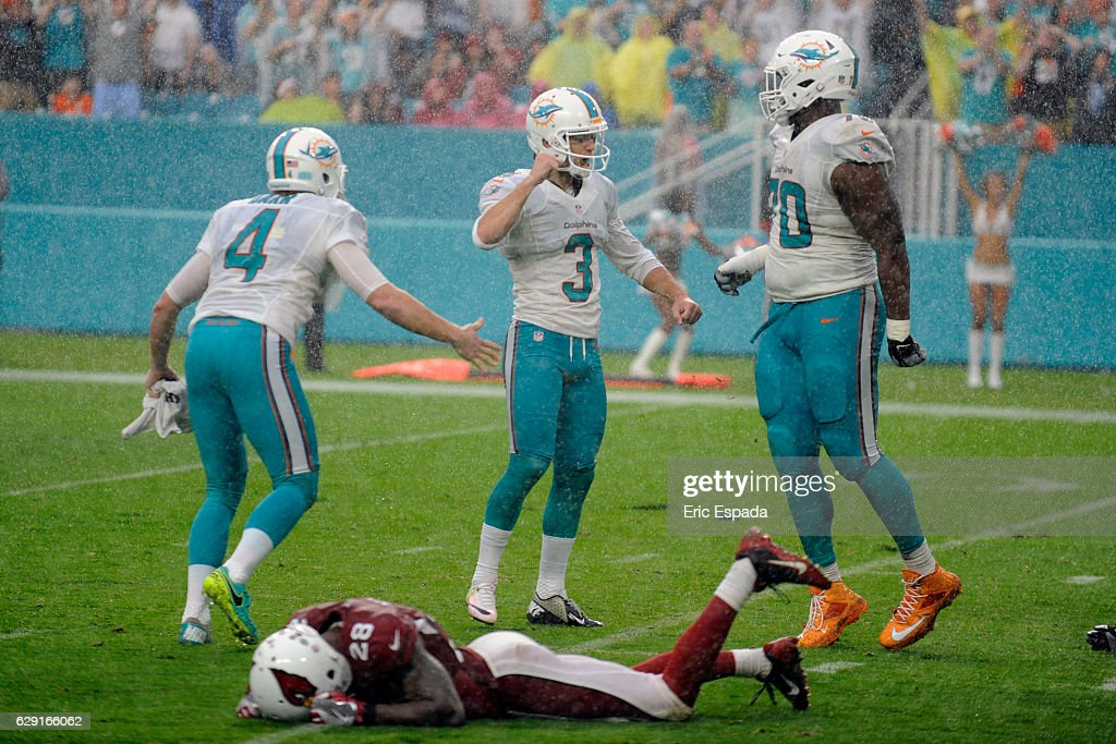 Andrew Franks #3 of the Miami Dolphins celebrates after kicking the game winning field goal against the Arizona Cardinals at Hard Rock Stadium on December 11, 2016 in Miami Gardens, Florida.
