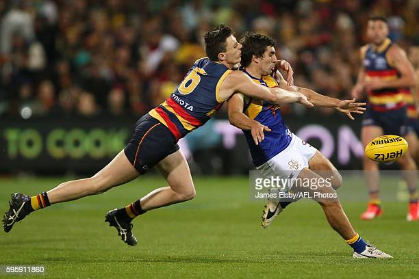 Andrew Gaff of the Eagles is tackled by Jake Lever of the Crows during the 2016 AFL Round 23 match between the Adelaide Crows and the West Coast...