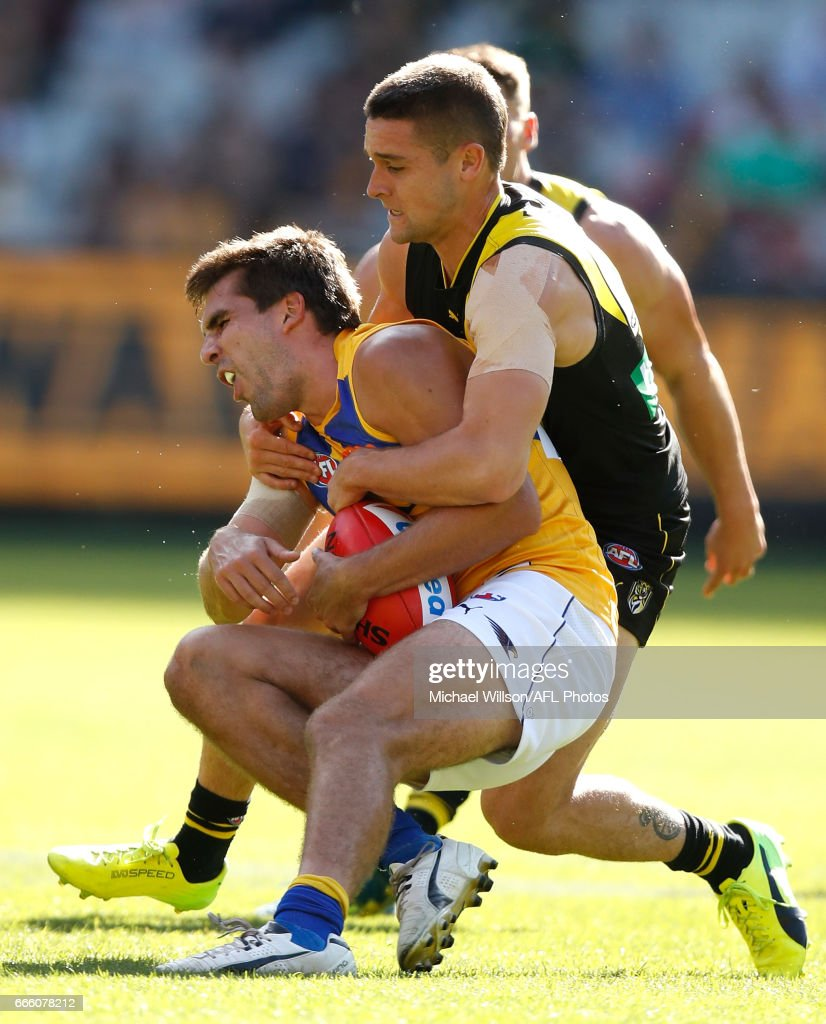 Andrew Gaff of the Eagles is tackled by Jayden Short of the Tigers during the 2017 AFL round 03 match between the Richmond Tigers and the West Coast Eagles at the Melbourne Cricket Ground on April 08, 2017 in Melbourne, Australia.